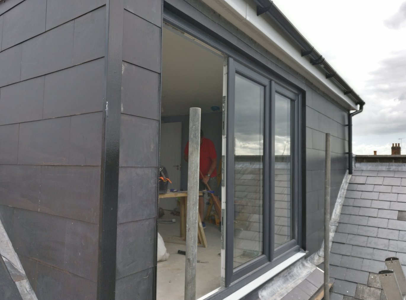 Loft with slate cladding